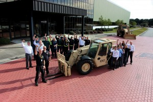 Employees at JCB's North American HQ celebrate news of the $142 million U.S. Army order